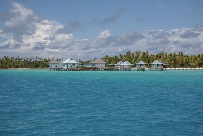 houses on stilts on the Tikehau Island, par of the Tuamotu Archipelago