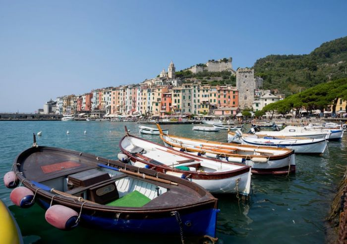 Coloured facade and laundry at the Porto Venere harbor on the Italian Riviera on August 07, 2018
