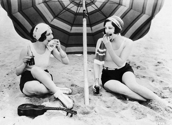 Two Actress Tasting Hamburgers At Club Casa Del Mar Beach in 1925