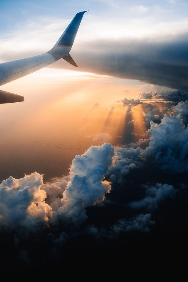 Sunset aboard an airplane after a severe storm