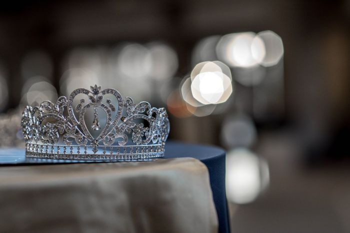 Tiara placed on a silk blue cloth in the Churg of the King