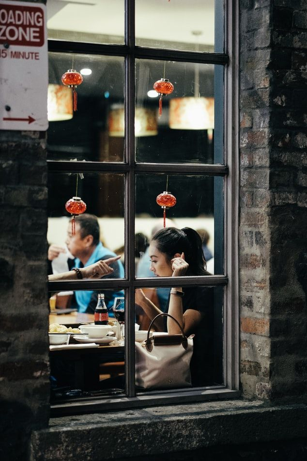 Woman leaning on table inside a Chinese restaurant