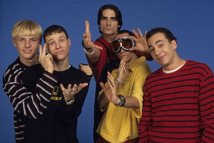 From left, American vocalists Nick Carter, Brian Littrell, AJ McLean, Kevin Richardson, and Howie Dorough, of the group the Backstreet Boys, attend a photo shoot, New York, 1997.