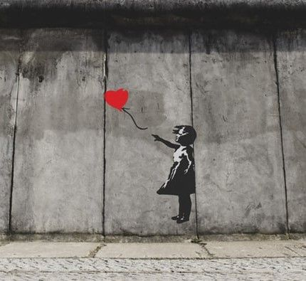 Girl with Balloon is a series of stencil murals by graffiti artists Banksy depicting a young girl with her hand out toward a red heart-shaped balloon carried away by the wind