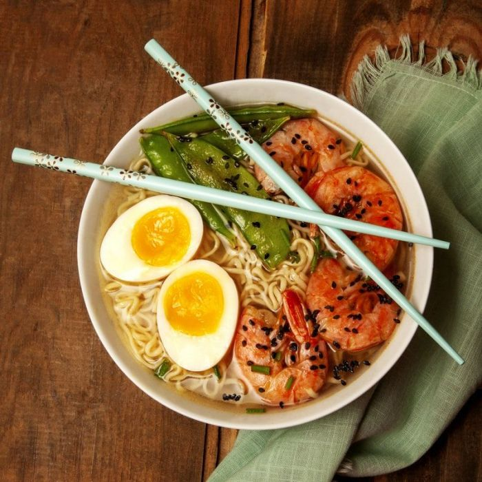 Ramen noodles with soft boiled egg, shrimp and snow peas.