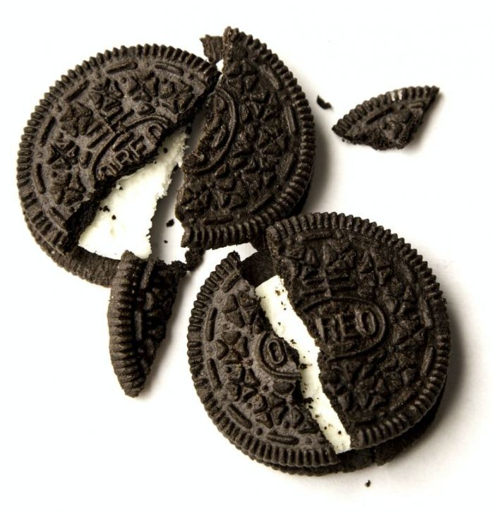 Classic Oreo cookies broken on a white background