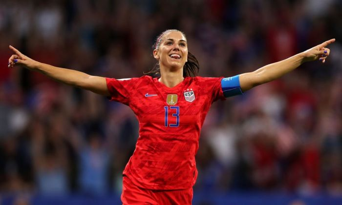 Alex Morgan of the USA celebrates after scoring her team's second goal during the 2019 FIFA Women's World Cup France Semi Final match