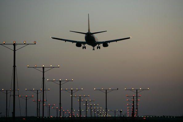 Airplane landing over lights