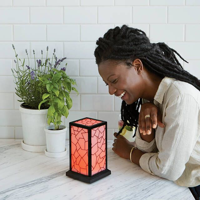 Woman laughing at friendship lamp